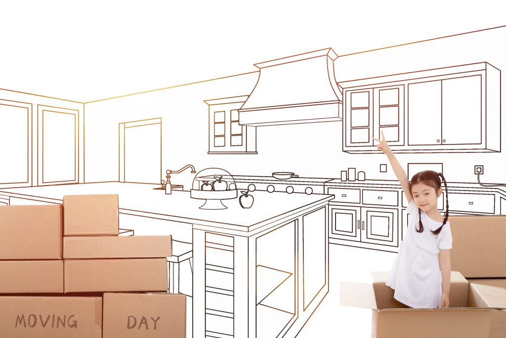 Girl moving boxes in kitchen
